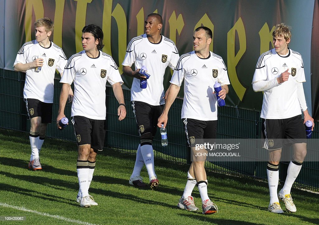 Germany's midfielder Marko Marin, Germany's defender Serdar Tasci, Germany's defender Jerome Boateng, Germany's defender Heiko Westermann, and Germany's striker Stefan Kiessling watch their comrades play during a training match Germany vs Sued Tyrol FC at the team's training centre in Appiano, near the north Italian city of Bolzano May 24, 2010. The German football team is currently taking part in a 12-day training camp in Appiano to prepare for the upcoming FIFA Football World Cup in South Africa.