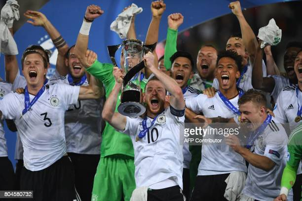 Germany's midfielder Maximilian Arnold and teammates celebrate 10 victory with the trophy after the UEFA U21 European Championship football final...