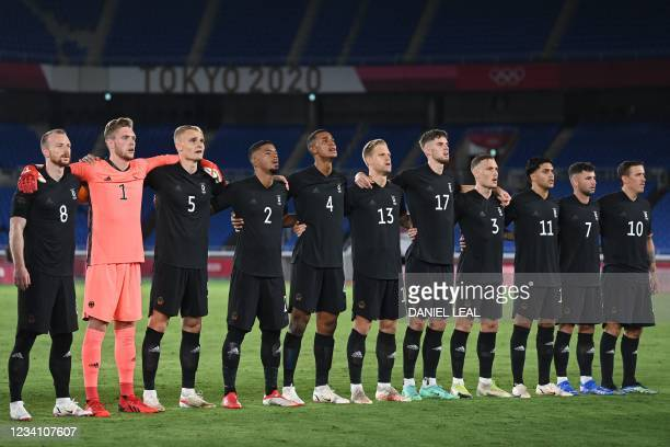 Germany's midfielder Maximilian Arnold, Germany's goalkeeper Florian Mueller, Germany's defender Amos Pieper, Germany's defender Benjamin Henrichs,...