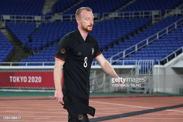 Germany's midfielder Maximilian Arnold leaves the pitch after he received a red card during the Tokyo 2020 Olympic Games men's group D first round...
