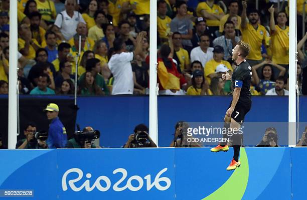 Germany's midfielder Maximilian Meyer celebrates scoring his team's first goal during the Rio 2016 Olympic Games men's football gold medal match...