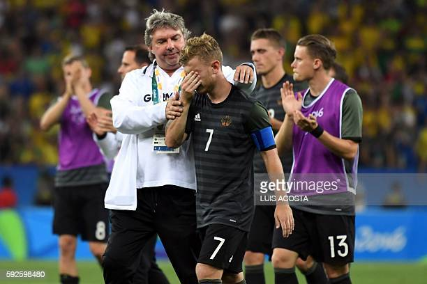 Germany's midfielder Maximilian Meyer is consolled following the Rio 2016 Olympic Games men's football gold medal match between Brazil and Germany at...