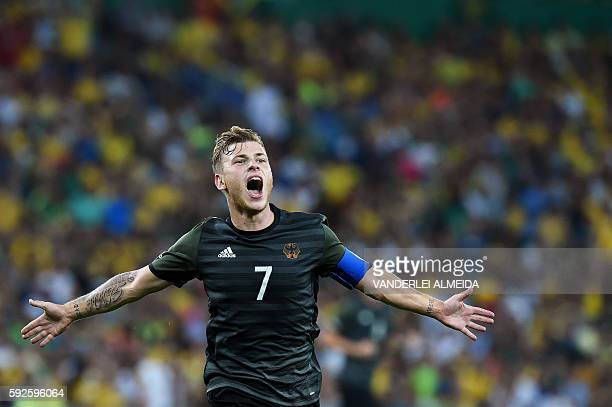 TOPSHOT Germany's midfielder Maximilian Meyer scores his team's first goal during the Rio 2016 Olympic Games men's football gold medal match between...