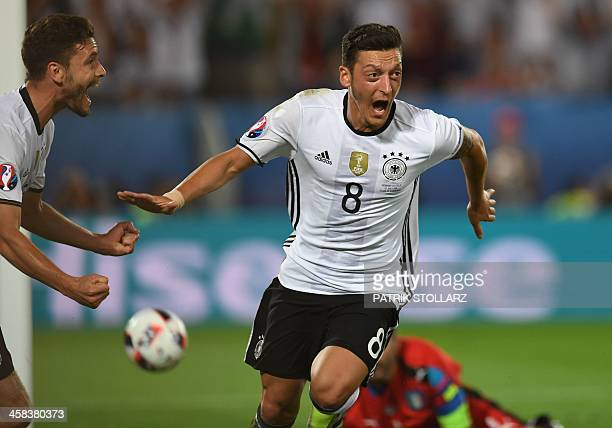 Germany's midfielder Mesut Oezil celebrates after scoring during the Euro 2016 quarter-final football match between Germany and Italy at the Matmut...
