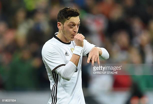 Germany's midfielder Mesut Oezil celebrates scoring a penalty for the 40 goal during the friendly football match Germany vs Italy in Muinch southern...