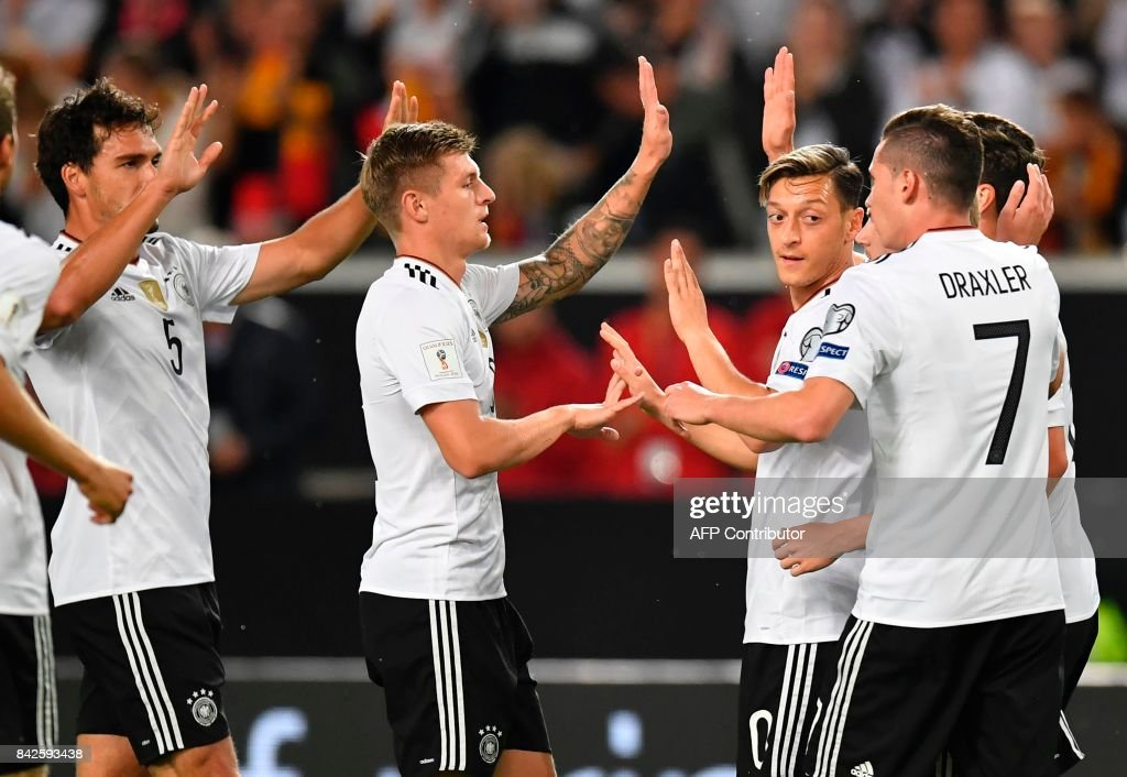 Germany's midfielder Mesut Oezil (C) celebrates with teammates after scoring the opening goal during the FIFA World Cup 2018 qualification match between Germany and Norway in the south German city of Stuttgart on September 4, 2017. /