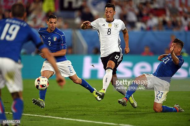 Germany's midfielder Mesut Oezil kicks the ball and scores during the Euro 2016 quarterfinal football match between Germany and Italy at the Matmut...