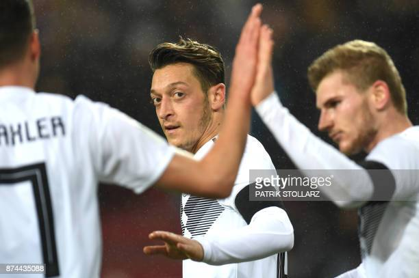 Germany's midfielder Mesut Oezil reacts during the international friendly football match Germany against France in Cologne on November 14 2017 / AFP...