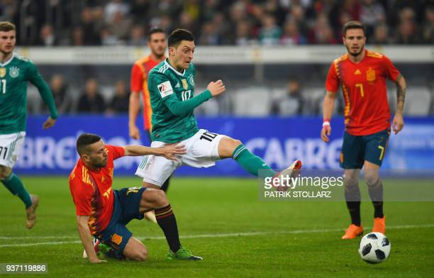 Germany's midfielder Mesut Ozil and Spain's defender Jordi Alba vie for the ball during the international friendly football match of Germany vs Spain...
