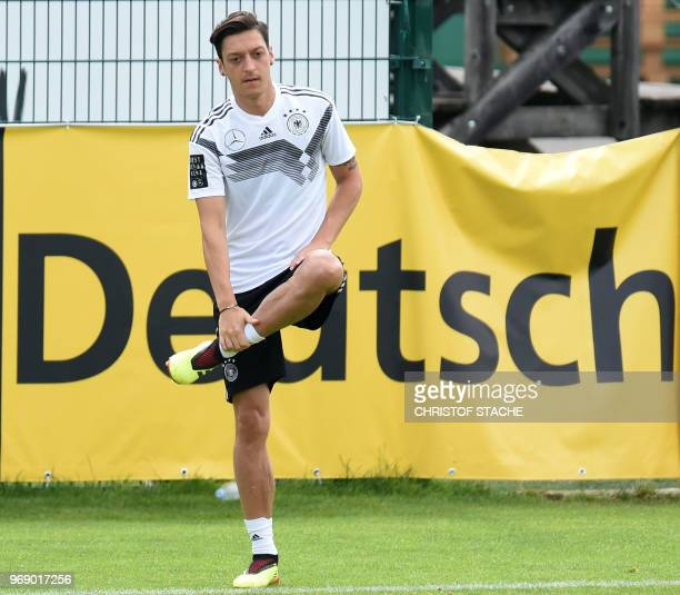 Germany's midfielder Mesut Ozil stretches during a training session of the German national football team at the Rungghof training centre on June 7...
