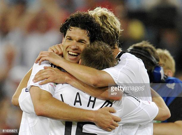 Germany's midfielder Michael Ballack and defender Philipp Lahm celebrate Ballack's goal during the Euro 2008 Championships quarterfinal football...