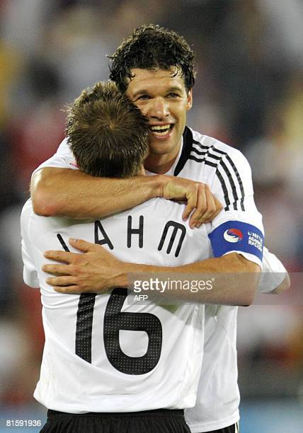 Germany's midfielder Michael Ballack and Germany's defender Philipp Lahm celebrate after the Euro 2008 final group B match Austria vs Germany at the...