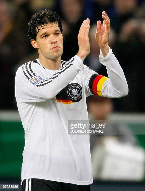 Germany's midfielder Michael Ballack applauds after the Germany vs Wales football World Cup 2010 group 4 qualifying match at the BorussiaPark in...