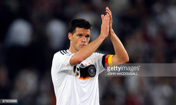Germany's midfielder Michael Ballack applauds the crowd at the end of the Germany vs Azerbaijan World Cup 2010 qualifying football match in Hanover...