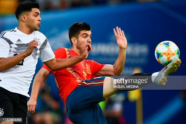 Germany's midfielder Nadiem Amiri and Spain's defender Martin Aguirregabiria go for the ball during the final match of the UEFA U21 European Football...