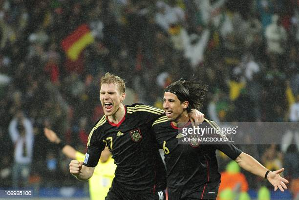 Germany's midfielder Sami Khedira and Germany's defender Per Mertesacker celebrate after Khedira scored a goal during the third place World Cup 2010...