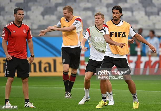 Germany's midfielder Sami Khedira and Germany's midfielder Toni Kroos warm up during a training session at The Mineirao Stadium in Belo Horizonte on...