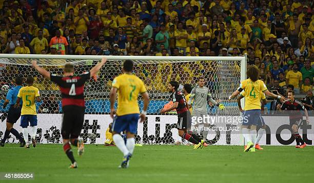 Germany's midfielder Sami Khedira celebrates after he scored his team's fifth goal during the semifinal football match between Brazil and Germany at...