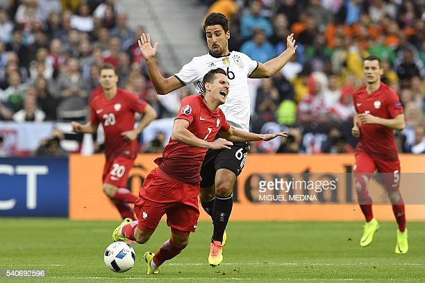 Germany's midfielder Sami Khedira commits a foul on Poland's forward Arkadiusz Milik during the Euro 2016 group C football match between Germany and...