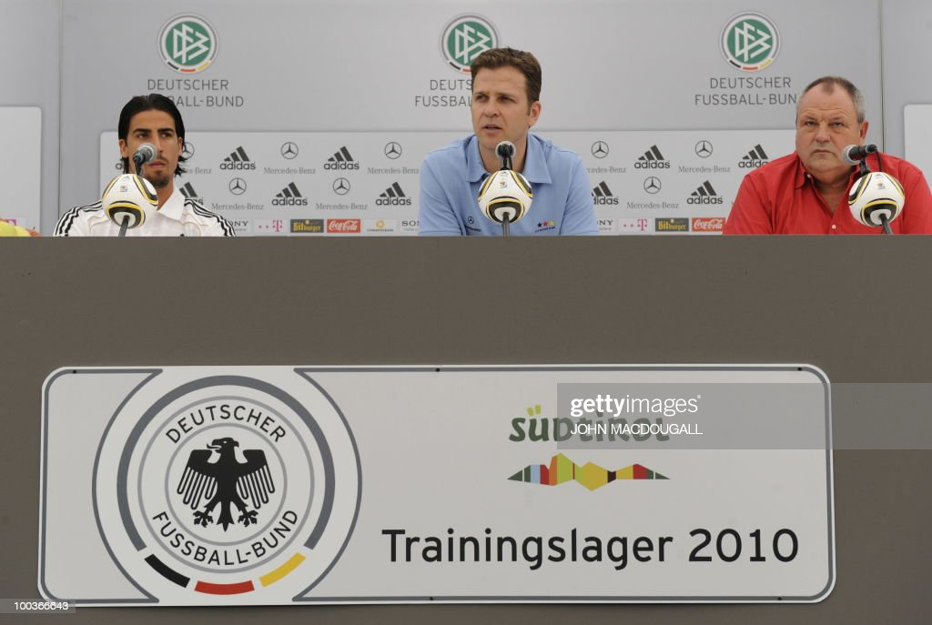 Germany's midfielder Sami Khedira, Germany's team manager Oliver Bierhoff, and team spokesman Harald Stenger address a press conference in Appiano, near the north Italian city of Bolzano May 24, 2010. The German football team is currently taking part in a 12-day training camp in Appiano to prepare for the upcoming FIFA Football World Cup in South Africa.