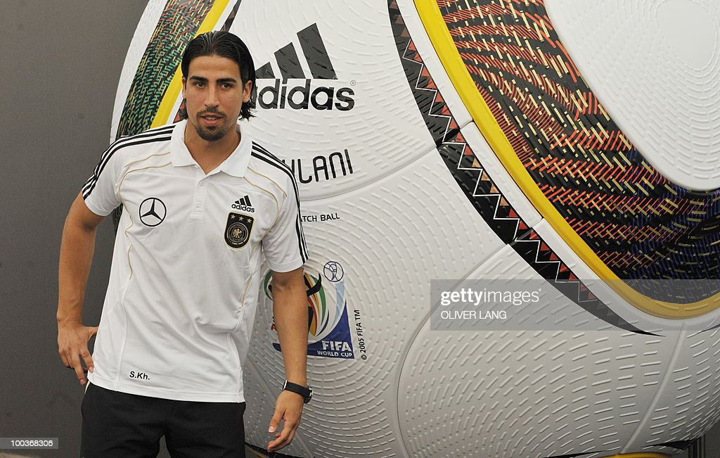 Germany's midfielder Sami Khedira poses next to a giant replica of Jabulani, the official ball of the FIFA 2010 Football World Cup, after addressing a press conference in Appiano, near the north Italian city of Bolzano May 24, 2010. The German football team is currently taking part in a 12-day training camp in Appiano to prepare for the upcoming FIFA Football World Cup in South Africa.