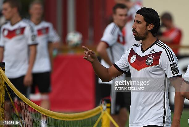 Germany's midfielder Sami Khedira reacts as he warms up during a training session in Santo Andre on July 10 ahead of the final match Argentina vs...