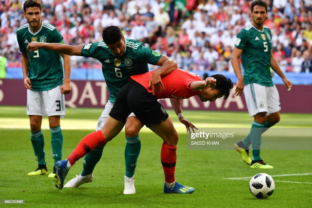 Germany's midfielder Sami Khedira (L) vies for the ball with South Korea's forward Son Heung-min during the Russia 2018 World Cup Group F football match between South Korea and Germany at the Kazan Arena in Kazan on June 27, 2018. (Photo by SAEED KHAN / AFP) / RESTRICTED
