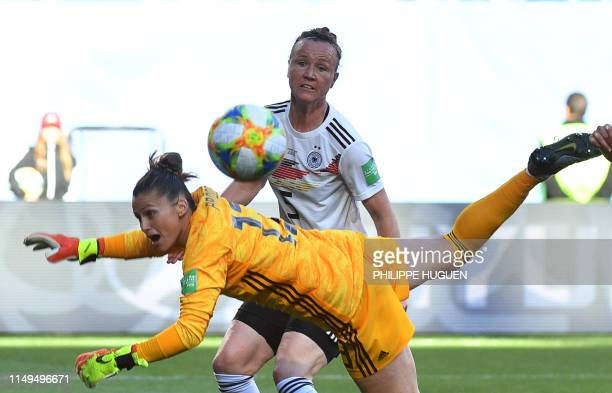 Germany's midfielder Sara Dabritz dives as Germany's defender Marina Hegering reacts during the France 2019 Women's World Cup Group B football match...