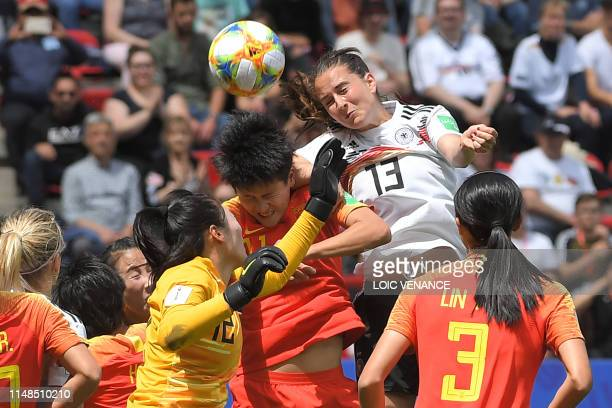 Germany's midfielder Sara Dabritz vies for the ball with China's forward Shanshan Wang and China's goalkeeper Shimeng Peng during the France 2019...