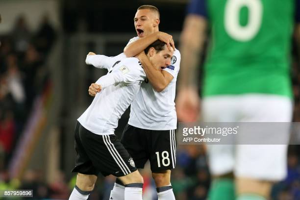 Germany's midfielder Sebastian Rudy celebrates with Germany's defender Joshua Kimmich after scoring the opening goal of the FIFA World Cup 2018...