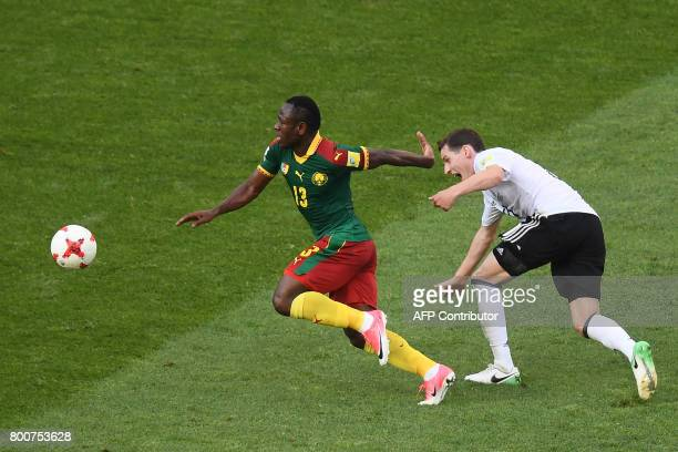 Germany's midfielder Sebastian Rudy challenges Cameroon's forward Christian Bassogog during the 2017 FIFA Confederations Cup group B football match...