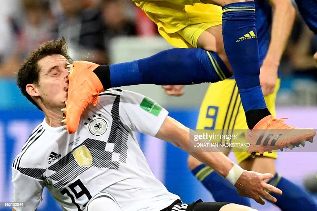 Germany's midfielder Sebastian Rudy is hit in the face during the Russia 2018 World Cup Group F football match between Germany and Sweden at the Fisht Stadium in Sochi on June 23, 2018. (Photo by Jonathan NACKSTRAND / AFP) / RESTRICTED