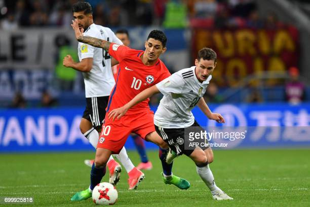 Germany's midfielder Sebastian Rudy vies with Chile's midfielder Pablo Hernandez during the 2017 Confederations Cup group B football match between...