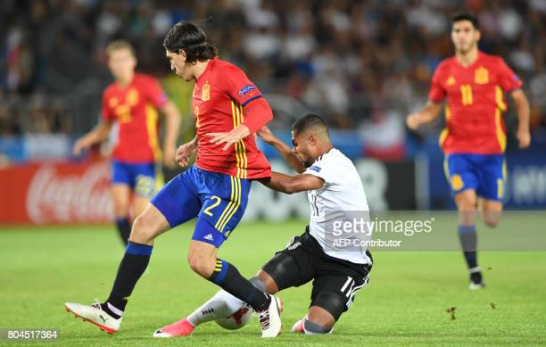 Germany's midfielder Serge Gnabry and Spain's defender Hector Bellerin vie for the ball during the UEFA U21 European Championship football final...