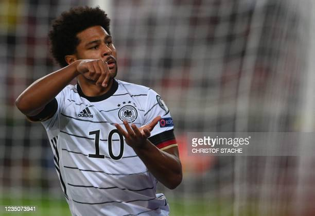 Germany's midfielder Serge Gnabry celebrates scoring during the FIFA World Cup Qatar 2022 qualification Group J football match between Germany and...