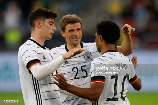 Germany's midfielder Serge Gnabry celebrates scoring the 5-0 goal with Germany's midfielder Kai Havertz and Germany's forward Thomas Mueller during...