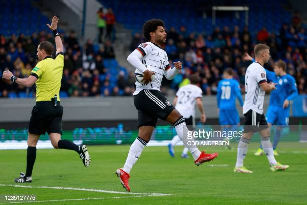 Germany's midfielder Serge Gnabry celebrates scoring the opening goal during the FIFA World Cup Qatar 2022 qualification Group J football match...