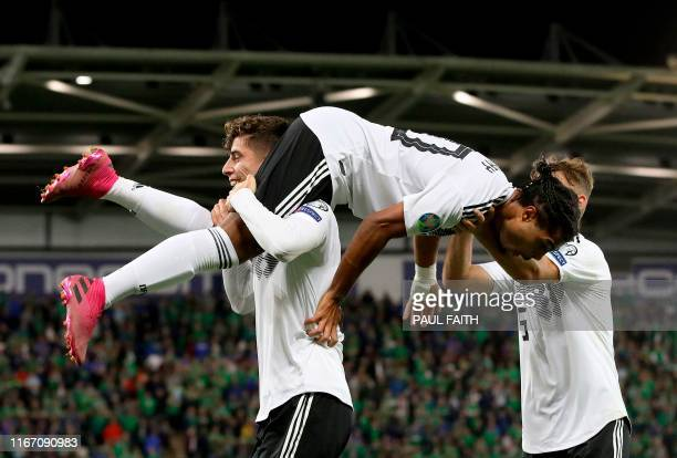 Germany's midfielder Serge Gnabry celebrates scoring their second goal during the the Euro 2020 football qualification match between Northern Ireland...