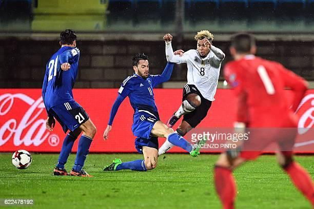Germany's midfielder Serge Gnabry vies San Marino's defender Tommaso Zafferani during the World Cup 2018 qualifying football match between San Marino...