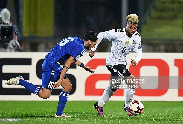 Germany's midfielder Serge Gnabry vies with San Marino's defender Davide Simoncini during the World Cup 2018 qualifying soccer match San Marino vs...