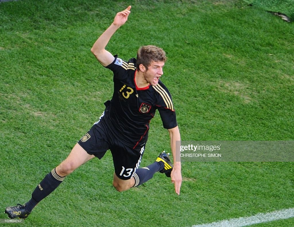 Germany's midfielder Thomas Mueller celebrates after scoring during the 2010 World Cup quarter final Argentina vs Germany on July 3, 2010 at Green Point stadium in Cape Town. NO