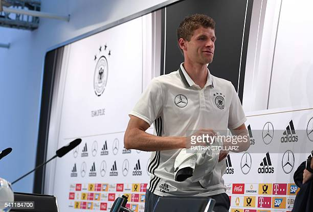 Germany's midfielder Thomas Mueller leaves after addressing a press conference at their training grounds in EvianlesBains eastern France on June 19...