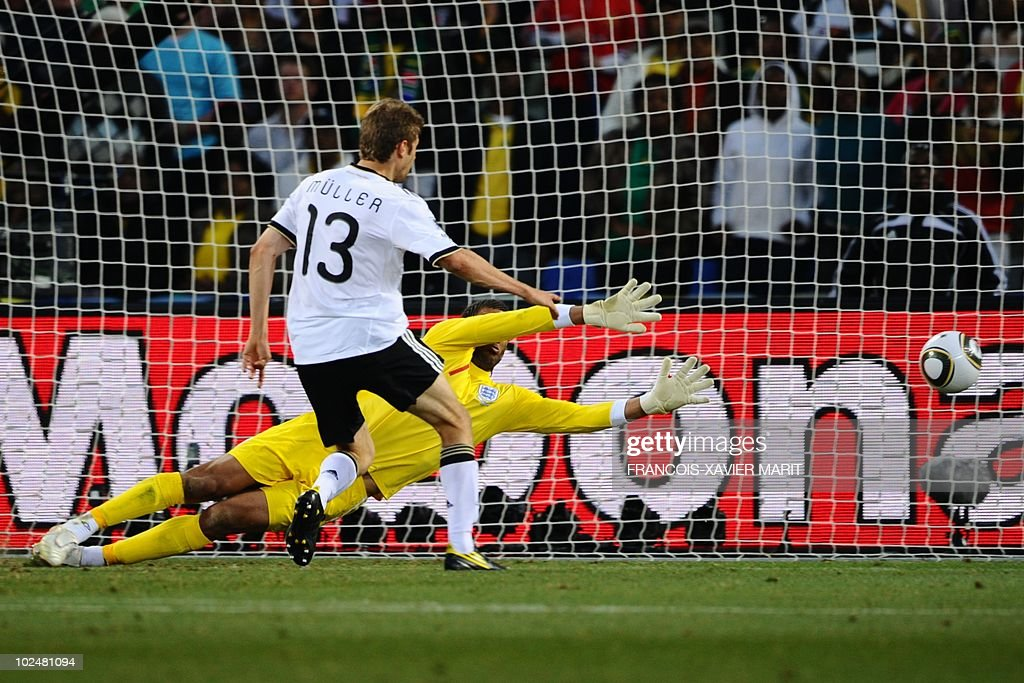 Germany's midfielder Thomas Mueller (L) scores past England's goalkeeper David James during the 2010 World Cup round of 16 football match Germany vs. England on June 27, 2010 at Free State stadium in Mangaung/Bloemfontein. NO