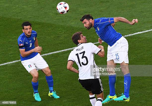 Germany's midfielder Thomas Mueller vies with Italy's midfielder Alessandro Florenzi and Italy's defender Andrea Barzagli during the Euro 2016...