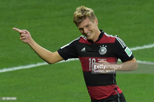 Germany's midfielder Toni Kroos celebrates after he scored his team's third goal during the semifinal football match between Brazil and Germany at...