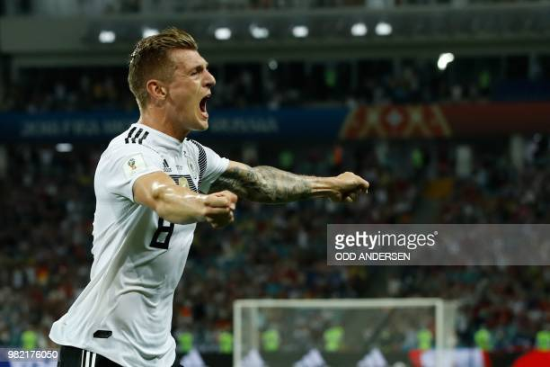 Germany's midfielder Toni Kroos celebrates after scoring a goal during the Russia 2018 World Cup Group F football match between Germany and Sweden at...