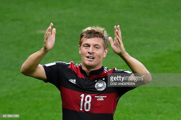 Germany's midfielder Toni Kroos celebrates after scoring during the semifinal football match between Brazil and Germany at The Mineirao Stadium in...