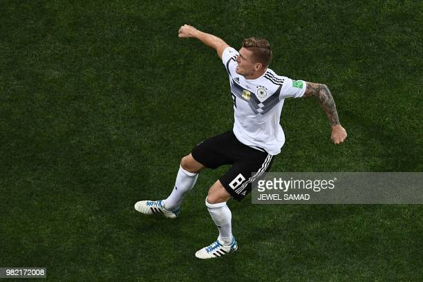 TOPSHOT Germany's midfielder Toni Kroos celebrates after scoring his team's second goal during the Russia 2018 World Cup Group F football match...