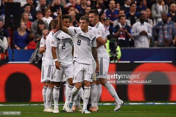 Germany's midfielder Toni Kroos celebrates after scoring the opener on a penalty kick during the UEFA Nations League football match between France...