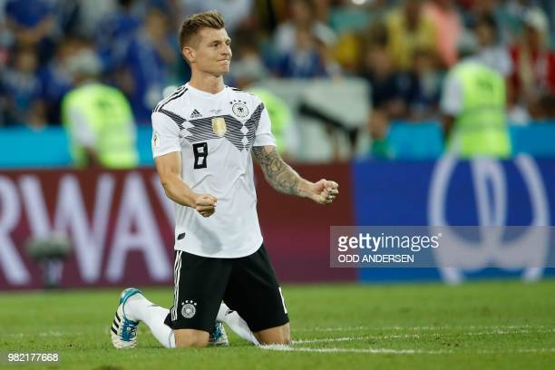 TOPSHOT Germany's midfielder Toni Kroos celebrates after winning at the end of the Russia 2018 World Cup Group F football match between Germany and...